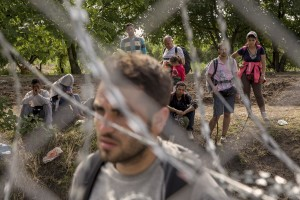 Migrants are seen near the Serbian border with Hungary in Rozske, Hungary on September 15, 2015. The right-wing nationalist government led by Viktor Orbán has closed the entire border with Serbia on September 15, 2015 after the entry into force of new rules that make it illegal and punishable by law. Hungary's border with Serbia has become a major crossing point into the European Union, with more than 160,000 access Hungary so far this year.