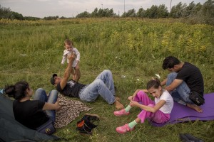 A Syrian family in a camp near the Serbian border with Hungary in Horgos, Serbia on September 16, 2015. Hungary's border with Serbia has become a major crossing point into the European Union for migrants, with more than 160,000 accessing Hungary so far this year.