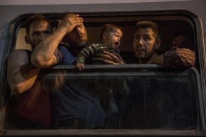 A man is in despair while his son cries after they have boarded on a train used by migrants to reach Zagreb and continue their journey to the North Europe at Tovarnik train station in Tovarnik, Croatia on September 18, 2015.