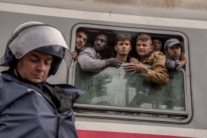 Tovarnik, Croatia: Police guard a train heading for Zagreb as migrants desperately try to continue their journey in the north of Europe despite moves by Slovenia and Hungary to hold them back in Tovarnik, Croatia on September 20, 2015.