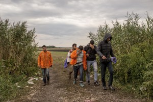 Migrants walk in a camp near Tovarnik train station in Croatia on September 20, 2015. From September 15, 2015 about 8,900 refugees entered Croatia and the authorities announced that they will have to restore border controls if the flow will remain buoyant.