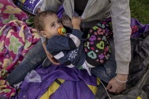 A Syrian woman with her daughter is seen near Tovarnik train station close to the croatian border with Serbia in Tovarnik, Croatia on September 18, 2015.