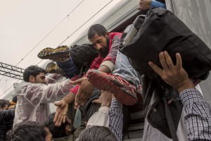Migrants try to get the train heading for Zagreb to continue their journey in the north of Europe despite moves by Slovenia and Hungary to hold them back in Tovarnik, Croatia on September 20, 2015.
