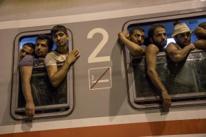 Migrants get on a train to reach Zagreb and continue their journey to the North Europe at Tovarnik train station in Tovarnik, Croatia on September 18, 2015.