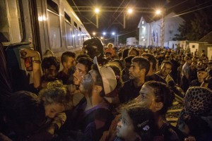 Migrants in Tovarnik train station getting on the train to continue their journey in the north of Europe despite moves by Slovenia and Hungary to hold them back in Tovarnik, Croatia on September 19, 2015. From September 15, 2015 about 8,900 refugees entered Croatia and the authorities announced that they will have to restore border controls if the flow will remain buoyant.