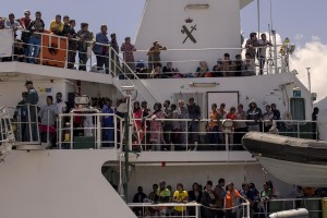 Migrants wait to disembark from the Spanish Guardia Civil Rio Segura Patrol Ship with 1216 migrants onboard including 256 children and 11 pregnant women, who were rescued in the Mediterranean sea in Salerno, Southern Italy on June 29, 2017.