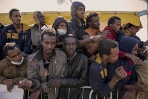 "Migrants expect to receive a meal after the arrive of the tanker ""Chimera"" with 545 immigrants in Salerno port on April 21, 2015. More than 500 migrants were rescued from the waters of the Mediterranean Sea in the last days."