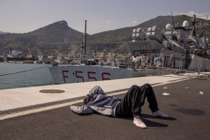 "A migrant destroyed by fatigue after the arrive of the tanker ""Chimera"" with 545 immigrants in Salerno port on April 21, 2015. More than 500 migrants were rescued from the waters of the Mediterranean Sea in the last days."