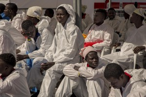 SALERNO, ITALY – MAY 26: Migrants affected by scabies are seen at Manfredi pier of Salerno port after the arrival of the Aquarius rescue ship run by NGO S.O.S. Mediterranee and Medecins Sans Frontieres on May 26 2017. More than 1000 migrants including 240 children disembark from the Aquarius today.