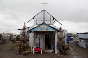 "January 27, 2016 – Calais, France: An Evangelist church inside the migrants camp of Calais, known as ""The Jungle"". While migrants have for years sought to cross over to Britain from Calais, the numbers have shot up since the refugee crisis went into overdrive last year."