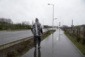"January 27, 2016 – Calais, France: A migrant walks outside the camp of Calais, known as ""The Jungle"" where thousands of migrants live. While migrants have for years sought to cross over to Britain from Calais, the numbers have shot up since the refugee crisis went into overdrive last year."