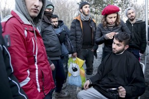 "January 30, 2016 – Grande-Synthe, France: A volunteer cuts migrants hair inside the refugee camp of Grande-Synthe near Dunkirk, northern France, known as ""The Jungle 2″. Around 3,000 refugees and migrants of Kurdish descent from Iraq and Syria live in the camp."