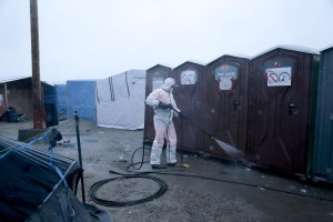 "January 27, 2016 – Calais, France: Cleaning inside the migrants camp of Calais, known as ""The Jungle"". While migrants have for years sought to cross over to Britain from Calais, the numbers have shot up since the refugee crisis went into overdrive last year."