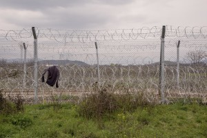 A vest is seen on the barbed wire of the border fence at the Idomeni refugee camp on the Greek Macedonian border in Idomeni, Greece on March 16, 2016.
