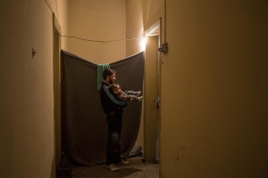 A Syrian man with his daughter in a corridor of the railway station near the Idomeni refugee camp on the Greek Macedonia border in Idomeni, Greece on March 17, 2016.