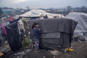 A girl is seen inside the refugee camp along the border of Greece and Macedonia near the town of Idomeni, in Greece on March 17, 2016. The refugees are being stopped from moving beyond Greece and have been languishing in the rain, mud, and cold with insufficient food and medical care while sleeping in small tents.