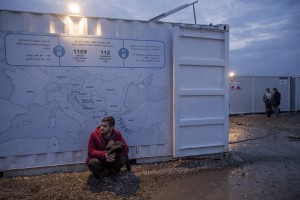 "A migrant is seen outside a public bathroom where a map of Europe is posted in the makeshift camp at the Greek-Macedonian border near the village of Idomeni in Greece on March 17, 2016. Refugees' ""journey of hope"" towards Western European countries where they dream of having a better life ends in the Balkans following the latest deal between Turkey and EU."