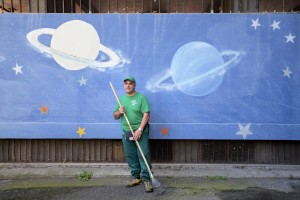 """June 8, 2016 – Naples, Italy: The member of the association """"Pollici Verdi"""" Vincenzo Sorrentino is portrayed near a mural inside """"Corto Maltese"""" park in Scampia district. Since three years a group of citizens called """"Pollici Verdi"""" take care of """"Corto Maltese"""" pak and self-tax with about 10 euro per month each, with the goal of saving the municipal gardens from degradation."""