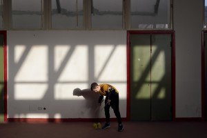 """February 24, 2016 – Naples, Italy: A child plays during a lesson of circus disciplines, a social project held by teachers Maria Teresa Cesaroni and Jack Sanchez Mc Guirk aimed at young people at risk living in Scampia district inside """"Officina delle Culture"""". """"Officina delle culture"""" is a multi-purpose center born in the Neapolitan neighborhood of Scampia and dedicated to Gelsomina Verde, an innocent victim of Camorra. The site is run by the association """"Resistenza Anticamorra"""" and its objective is to offer concrete alternatives to children at risk but also to prisoners who have no restrictive measures."""
