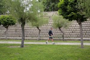 May 29, 2016 – Naples, Italy: A man runs inside the Scampia public garden in Secondigliano district.