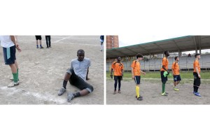 """Migrants coming mainly from Mali, Gambia and Nigeria play football with Italian boys during the national event """"Antiracist Mediterranean"""" in Scampia district, near Naples on May 13, 2016. """"Antiracist Mediterranean"""" has the aim to break down the barriers and constructs rights thanks to the sports instrument and culture."""