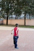 April 14, 2016 – Naples, Italy: A child is seen outside the Arci Scampia soccer school in Scampia district. The Football School is a non-profit company born in 1986 that since its establishment has always been sensitive to social problems of Scampia neighbourhood, acting as a reference point to protect children at risk.