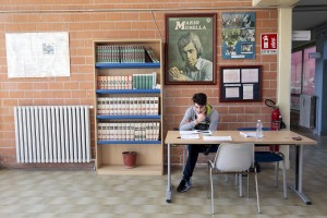 """March 2, 2016 – Naples, Italy: A student is seen inside the municipal  public library """"Domenico Severino"""" in Scampia."""