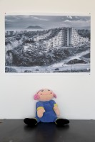 """March 13, 2016 – Naples, Italy – A poster depicting the """"Vele"""" palaces of Scampia and a puppet  are seen inside Chikù restaurant in Scampia, Secondigliano district."""