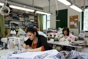 """April 14, 2016 – Naples, Italy: Women at work in the Hurtado center, an association who operates in Scampia and whose objective is the social integration of disadvantaged people by carrying out activities aimed to providing employment. The sewing workshop was established in 2004, within the Social Cooperative """"La Roccia"""" and in addition to the transfer of specific skills is designed to offer a peaceful growth in the values of the culture of work and legality."""