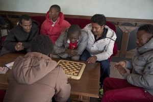 MONTESANO, ITALY – NOVEMBER 12: Migrants play checkers inside Hotel Rendez-Vous where about 40 migrants are hosted in Puglia, Southern Italy on November 12, 2016.
