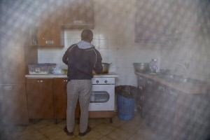 "LAGO PATRIA, ITALY – APRIL 23: A migrant prepares a meal inside the kitchen of ""Crescere Insieme"", a CAS (Extraordinary Reception Center) in Campania, Southern Italy on April 23, 2017. CAS are imagined in order to compensate the lack of places inside ordinary reception center in case of substantial arrivals of migrants."