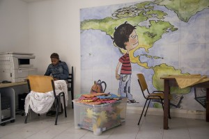 "GRUMO NEVANO, ITALY – APRIL 23: A woman rests in a classroom of ""CENTRO ASTALLI"", a CAS (Extraordinary Reception Center) in Campania, Southern Italy on April 23, 2017. CAS are imagined in order to compensate the lack of places inside ordinary reception center in case of substantial arrivals of migrants."
