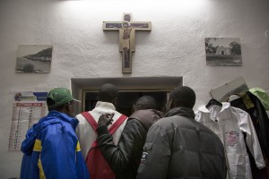 TRICASE, ITALY – NOVEMBER 12: Migrants are seen while they are looking for clothes inside the Caritas of Sant' Antonio da Padova Church in Puglia, Southern Italy on November 12, 2016.