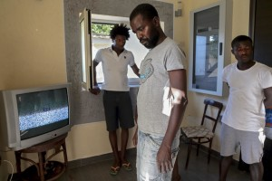 "July 19, 2016 – Naples, Italy: Migrants watch television inside ""Villa Chianese"", a C.A.S. (Extraordinary Reception Center) in Chiaiano, near Naples, southern Italy. CAS are imagined in order to compensate the lack of places inside ordinary reception center in case of substantial arrivals of migrants."