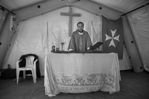 AMATRICE, ITALY – AUGUST 28: Domenico Pompili, Bishop of Rieti is seen during a mass inside a tent in Amatrice, Italy on August 28, 2016. Italy was struck by a powerful, 6.2 magnitude earthquake in the night of August 24, 2016, which has killed about 297 people and devastated dozens of houses in the Lazio village of Amatrice, Pescara del Tronto and Accumoli.