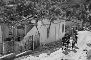 PESCARA DEL TRONTO, ITALY – AUGUST 25: A woman with fire fighters reach her destroyed house after a strong earthquake hit Pescara del Tronto, Italy on August 25, 2016. Italy was struck by a powerful, 6.2 magnitude earthquake in the night of August 24, 2016, which has killed at least 297 people and devastated dozens of houses in the Lazio village of Pescara del Tronto, Accumoli and Amatrice.