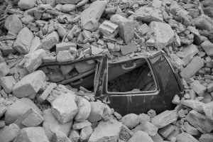 LAZIO, ITALY – AUGUST 24: A car crushed by rubble after a strong earthquake hit Amatrice on August 24, 2016. Italy was struck by a powerful, 6.2-magnitude earthquake in the night, which has killed at least 297 people and devastated dozens of houses in the Lazio village of Amatrice.