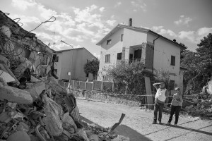 AMATRICE, ITALY – AUGUST 26: People looks at buildings destroyed in Amatrice, in Italy on August 26, 2016. Italy was struck by a powerful, 6.2 magnitude earthquake in the night of August 24, 2016, which has killed at least 297 people and devastated dozens of houses in the Lazio village of Pescara del Tronto, Accumoli and Amatrice.