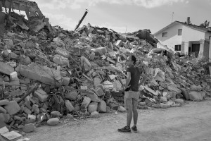 AMATRICE, ITALY – AUGUST 26: A man looks at destroyed buildings in Amatrice, in Italy on August 26, 2016. Italy was struck by a powerful, 6.2 magnitude earthquake in the night of August 24, 2016, which has killed at least 297 people and devastated dozens of houses in the Lazio village of Amatrice, Pescara del Tronto and Accumoli.