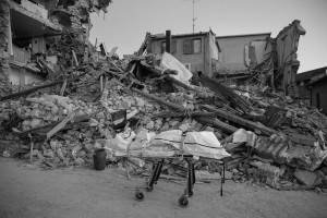 LAZIO, ITALY – AUGUST 24: The body of a person dead is seen on a stretcher after a strong earthquake hit Amatrice on August 24, 2016. Italy was struck by a powerful, 6.2-magnitude earthquake in the night, which has killed at least 297 people and devastated dozens of houses in the Lazio village of Amatrice.