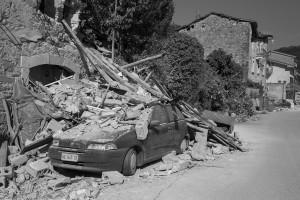 PESCARA DEL TRONTO, ITALY – AUGUST 25: A damaged car is seen after a strong earthquake hit Pescara del Tronto, Italy on August 25, 2016. Italy was struck by a powerful, 6.2-magnitude earthquake in the night, which has killed at least 297 people and devastated dozens of houses in the Lazio village of Pescara del Tronto.
