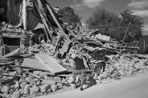 PESCARA DEL TRONTO, ITALY – AUGUST 25: A man stands near a destroyed building after a strong earthquake hit Pescara del Tronto, Italy on August 25, 2016. Italy was struck by a powerful, 6.2-magnitude earthquake in the night, which has killed at least 297 people and devastated dozens of houses in the Lazio village of Pescara del Tronto.