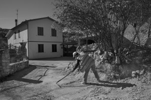 NORCIA, ITALY, NOVEMBER 1: A man cleans the ground from debris in Savelli, near Norcia, Italy, on November 1, 2016. A 6.5 magnitude earthquake hit central Italy on October 30, 2016.
