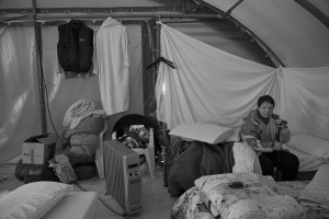 NORCIA, ITALY, NOVEMBER 2: A woman is seen inside a tent, in a camp set in Ancarano, near Norcia, Italy, on November 2, 2016. A 6.5 magnitude earthquake hit central Italy on October 30, 2016.