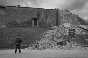 NORCIA, ITALY, NOVEMBER 2: A policeman patrols the partially collapsed Saint Anthony church in Norcia, Italy, on November 2, 2016. A 6.5 magnitude earthquake hit central Italy on October 30, 2016.