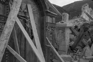 NORCIA, ITALY, NOVEMBER 2: A crucifix is seen in the collapsed San Salvatore church in the village of Campi near Norcia, in Italy, on November 2, 2016. A 6.5 magnitude earthquake hit central Italy on October 30, 2016.