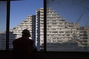 "A man at work during the transfer of a family from an apartment inside the ""Vele"" of Scampia to a new accommodation realized always in Scampia, in Naples on November 10, 2016. The ""vele"" of Scampia, become famous for the long and bloody Camorra feuds, will be demolished starting from spring 2017."