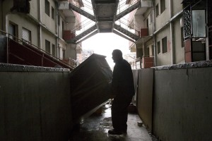 """A man is seen during the transfer from an apartment inside the """"Vele"""" of Scampia to a new accommodation realized always in Scampia, in Naples on November 11, 2016. The """"vele"""" of Scampia, become famous for the long and bloody Camorra feuds, will be demolished starting from spring 2017."""