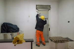 "A man at work inside an apartment in the ""Vele"" of Scampia, during the transfer of a family into one of the new accommodations realized always in Scampia, in Naples on November 11, 2016. The ""vele"" of Scampia, become famous for the long and bloody Camorra feuds, will be demolished starting from spring 2017."