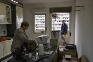 "A woman is seen in her apartment inside the ""vele"" of Scampia, before leaving it definitely and entering into one of the new accommodations realized always in Scampia, in Naples on November 11, 2016. The ""vele"" of Scampia, become famous for the long and bloody Camorra feuds, will be demolished starting from spring 2017."